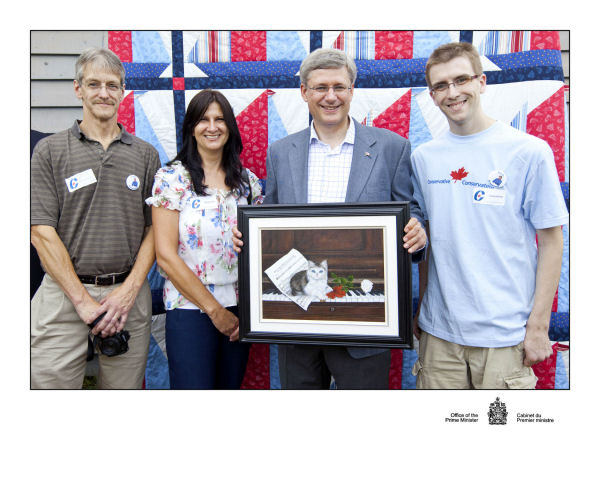 Presenting painting to Prime Minister Harper