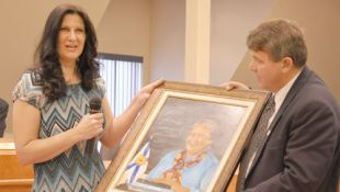 Janice Guinan explains details of her portrait of Willena Jones to Truro Mayor Bill Mills during town council's June meeting on Monday. The town purchased the artwork to be displayed as part of its permanent art collection. Jason Malloy - Truro Daily News